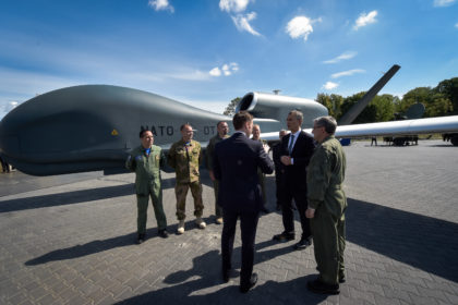 NATO Secretary General Jens Stoltenberg viewing the Global Hawk, Allied Ground Surveillance (AGS) display